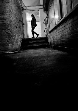 Stephen Mulcahey SILHOUETTED WOMAN ENTERING BUILDING Women