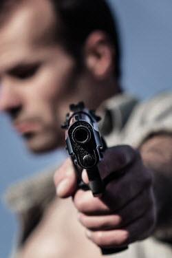 Magdalena Russocka close up of man aiming gun