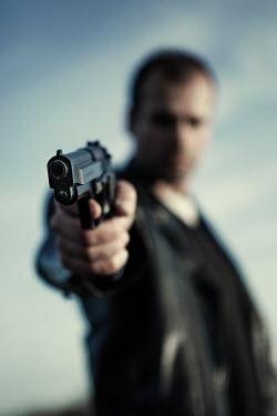 Magdalena Russocka man aiming gun outside