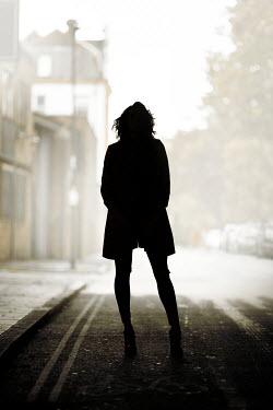 Miguel Sobreira SILHOUETTE OF WOMAN IN STREET Women