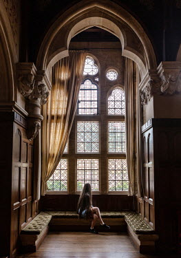 Maggie McCall GIRL SITTING BY GRAND WINDOW Women