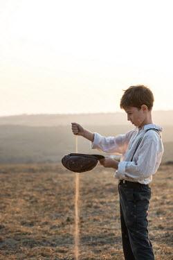 Galya Ivanova RETRO BOY WITH CAP SPILLING SOIL Children
