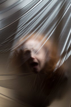 Holly Leedham TRAPPED WOMAN BEHIND PLASTIC SHEET Women