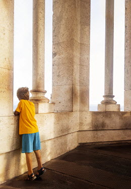 Kyle Stubbs LITTLE BOY AT WINDOW OF GRAND BUILDING Children