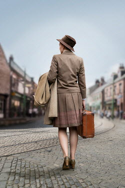 Stephen Mulcahey RETRO WOMAN WITH SUITCASE IN TOWN Women