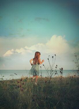 Mark Owen YOUNG GIRL RUNNING NEAR SEA Children
