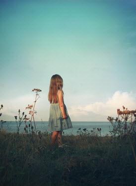 Mark Owen YOUNG GIRL STANDING NEAR SEA Children