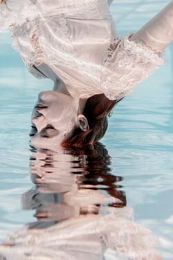 Rekha Garton WOMAN DIPPING HEAD IN WATER Women
