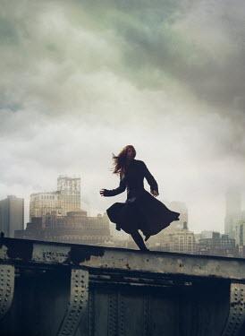 Mark Owen WOMAN RUNNING ON BRIDGE IN CITY Women