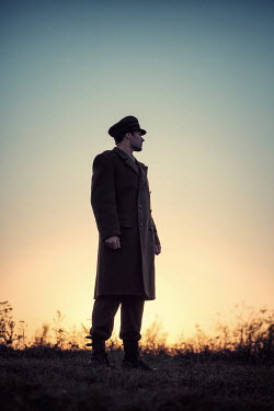 Magdalena Russocka silhouette of soldier standing on hill at sunset Men
