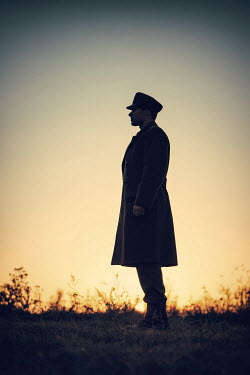 Magdalena Russocka silhouette of souldier standing on hill at sunset Men
