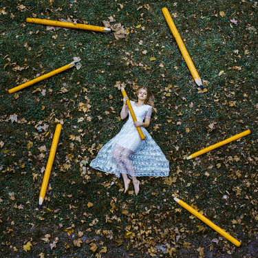 Jovana Rikalo WOMAN HOLDING GIANT YELLOW PENCIL Women