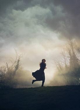 Mark Owen WOMAN RUNNING IN FIELD Women