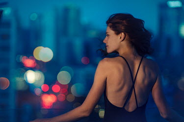Vanesa Munoz WOMAN LOOKING OUT OVER CITY Women