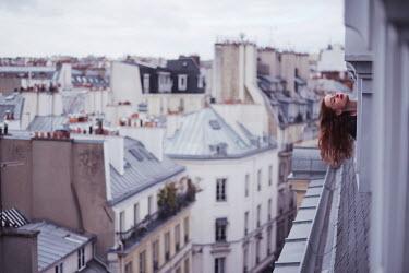 Anna Rakhvalova WOMAN LEANING OUT OF WINDOW IN CITY Women