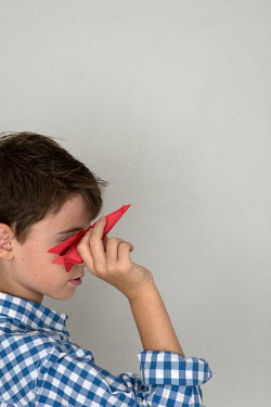 Galya Ivanova BOY THROWING RED PAPER PLANE Children