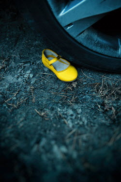 Magdalena Russocka child's shoe lying next to car wheel Miscellaneous Objects