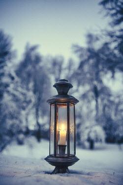 Magdalena Russocka lantern in snowy garden Snow/ Ice