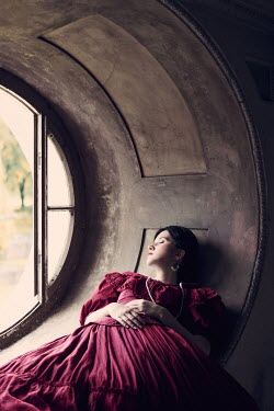Magdalena Russocka historical woman lying by window indoors Women