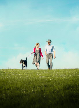 Mary Wethey COUPLE WALKING DOG IN SUMMERY FIELD Couples