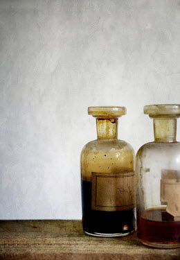 Jill Ferry OLD GLASS BOTTLES WITH BROWN LIQUID Miscellaneous Objects