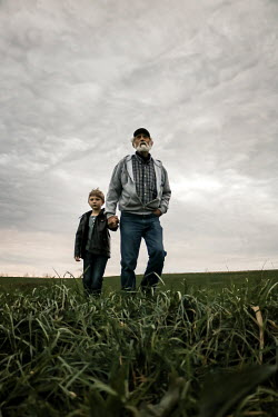 Stephen Carroll MAN HOLDING BOYS HAND IN FIELD Old People