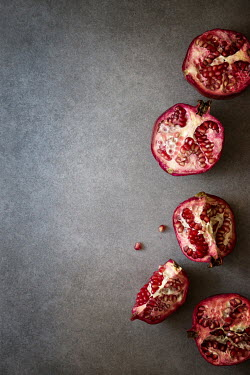 Galya Ivanova POMEGRANATES CUT IN HALF FROM ABOVE Miscellaneous Objects
