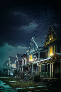 Sandra Cunningham Suburban houses with stormy night sky Houses
