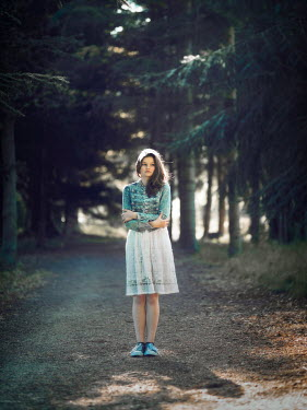 Mary Wethey SERIOUS GIRL STANDING IN FOREST Women