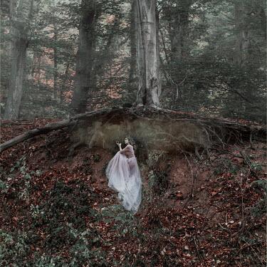 Jovana Rikalo WOMAN UNDER TREE ROOTS WITH SMOKE Women