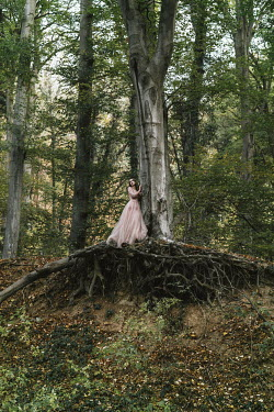 Jovana Rikalo WOMAN IN GOWN STANDING ON TREE ROOTS Women