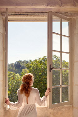 Holly Leedham WOMAN INDOORS OPENING WINDOWS IN SUMMER Women