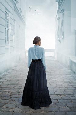 Ildiko Neer Historical woman standing in cobbled street Women