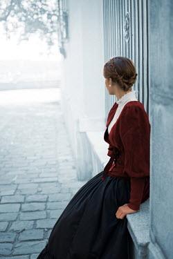 Ildiko Neer Historical woman sitting on window sill Women