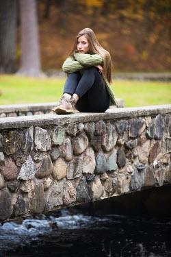 Terry Bidgood TEENAGER SITTING ON BRIDGE IN PARK Women