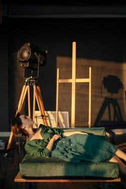 Marta Syrko WOMAN LYING ON GREEN MATTRESS Women