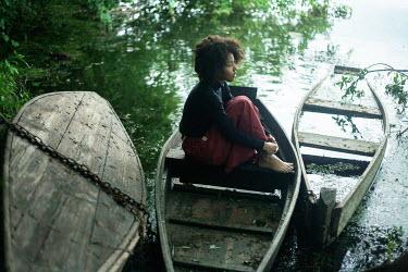 Dmitriy Bilous GIRL SITTING IN DERELICT BOATS Children