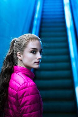 Magdalena Russocka TEENAGE GIRL WAITING BY ESCALATOR Women