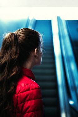 Magdalena Russocka girl waiting by escalator Women