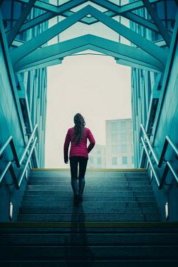 Magdalena Russocka modern woman climbing up urban steps Women