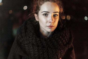 Dmitriy Bilous WOMAN IN WINTER COAT AT NIGHT Women