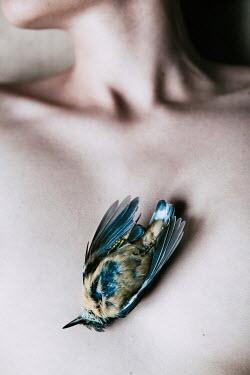 Magdalena Russocka dead bird lying on woman's bare chest Women