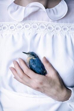 Magdalena Russocka woman holding daed bird Women