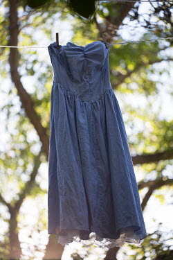 Alison Archinuk BLUE DRESS HANGING ON LINE IN SUMMER Miscellaneous Objects