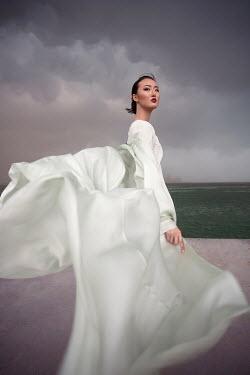 Aida Redzepagic ASIAN WOMAN IN WHITE ON BEACH Women