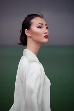 Aida Redzepagic SERIOUS ASIAN WOMAN BY SEA Women