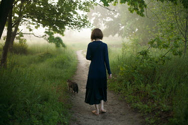 Dmitriy Bilous WOMAN AND CAT ON COUNTRY PATH Women