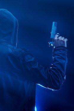 Mohamad Itani MAN IN HOOD WITH GUN Men