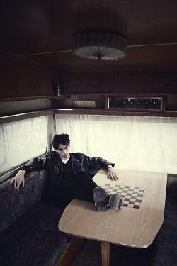 Magdalena Russocka modern man sitting inside caravan