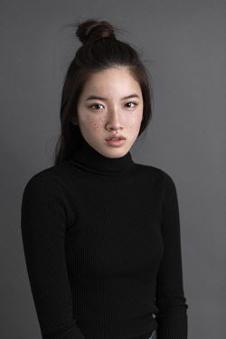Pauly Pholwises SERIOUS ASIAN GIRL IN POLO NECK Women